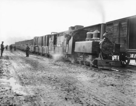 Transfer of ammunition from standard-gauge railway to trench railway during the Battle of Passchendaele.